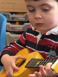 Little Boy Playing Ukulele
