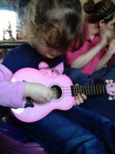 Little Girl Playing Pink Ukulele